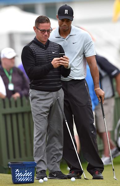 Golfer Tiger Woods with former coach Sean Foley during a practice session at Royal Liverpool Golf Course in England in July (AFP Photo/Paul Ellis)