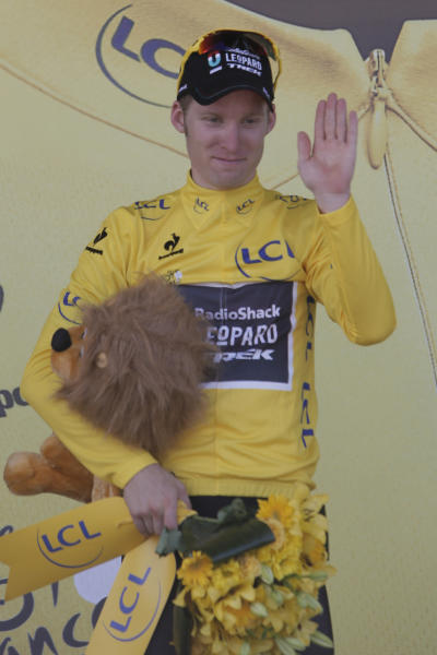 Jan Bakelants of Belgium, wearing the overall leader's yellow jersey, celebrates on the podium of the third stage of the Tour de France cycling race over 145.5 kilometers (91 miles) with start in Ajaccio and finish in Calvi, Corsica island, France, Monday July 1, 2013. (AP Photo/Laurent Rebours)