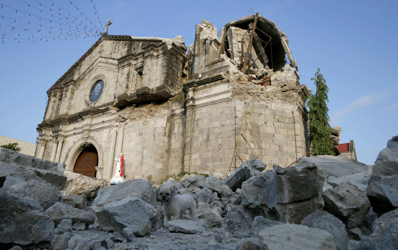 The damage of St. Catherine church, with its headless statue, is seen following a 6.1 magnitude earthquake that also caused the collapse of a commercial building in Porac township, Pampanga province, north of Manila, Philippines, Tuesday, April 23, 2019. The strong earthquake struck the northern Philippines Monday trapping some people in a collapsed building, damaged an airport terminal and knocked out power in at least one province, officials said. (AP Photo/Bullit Marquez)