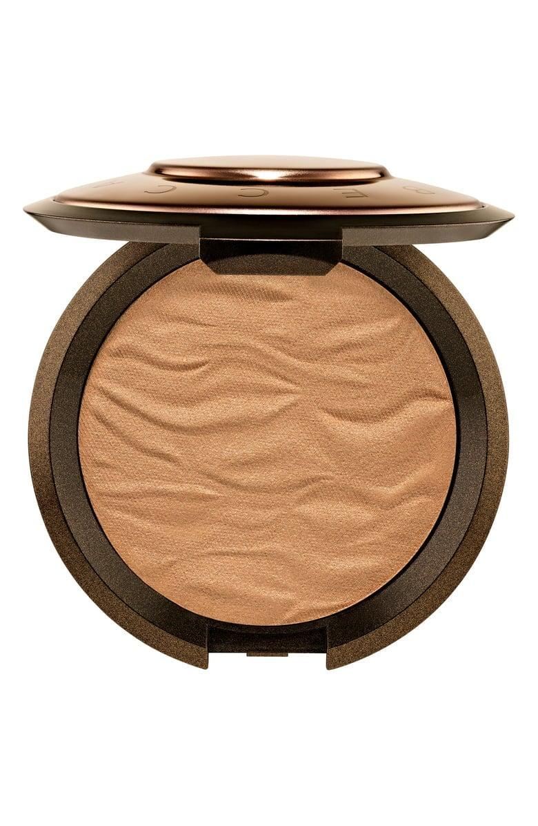 <p>The slightly shimmery <span>Becca Sunlit Bronzer</span> ($38) comes in four gorgeous shades to give you an epic glow. Use it on your face and body for a full-body glow. </p>