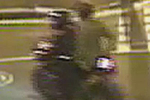 Police have released this image of two suspects on a motorbike (Met Police)