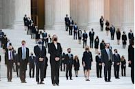 <p>People wait for the casket of the late Supreme Court Justice Ruth Bader Ginsburg to arrive at the US Supreme Court in Washington, DC, September 23, 2020.</p>