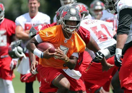 Jun 12, 2018; Tampa Bay, FL, USA; Tampa Bay Buccaneers quarterback Jameis Winston (3) runs with the ball as he works out during minicamp at One Buccaneer Place. Mandatory Credit: Kim Klement-USA TODAY Sports