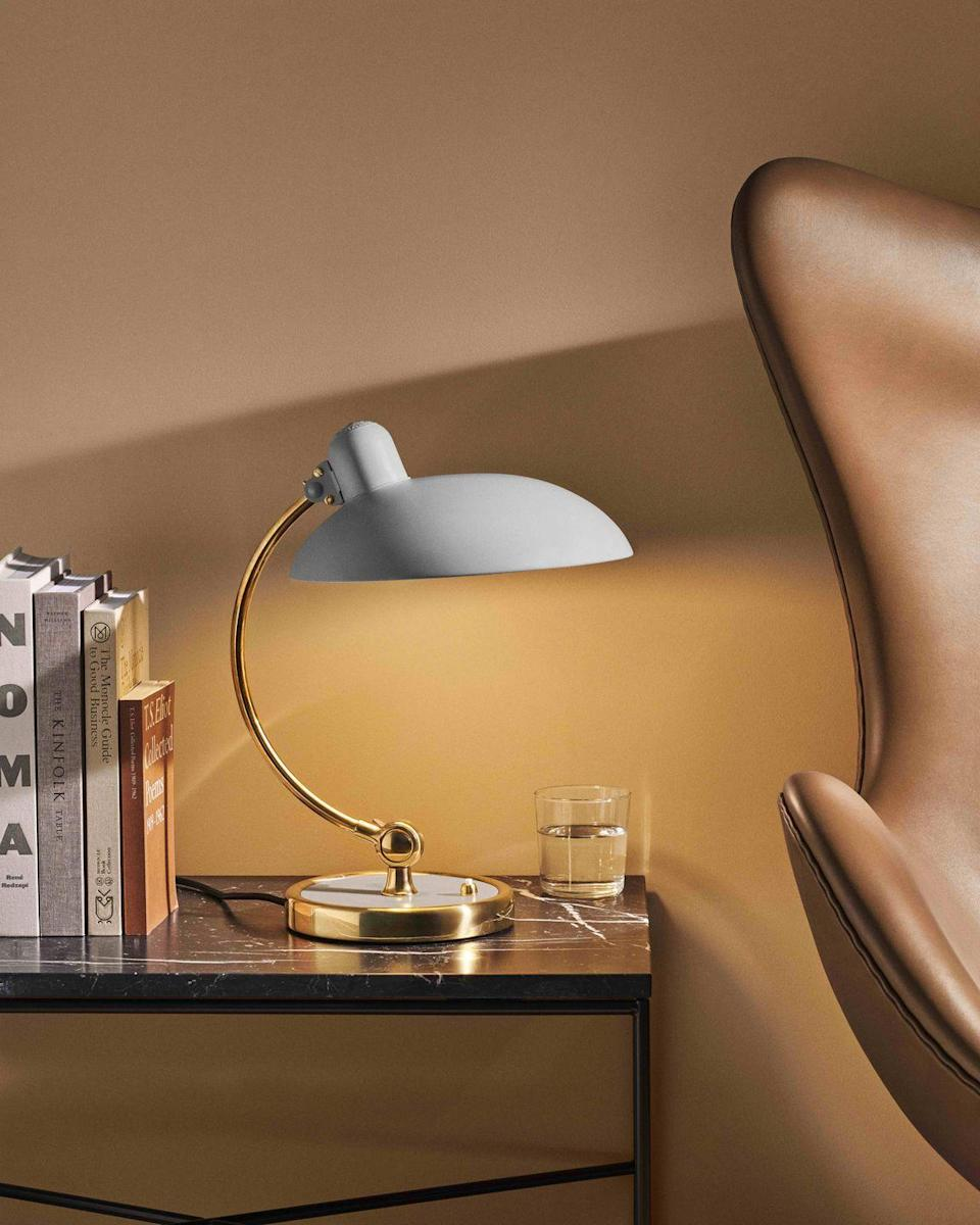 """<p>This iconic lamp was designed in 1931 by Christian Dell of the Bauhaus school and is now deemed a design classic. Place it in view during meetings, so people know you have true design credentials. £560, <a href=""""https://fritzhansen.com/en/products/Lighting/kaiser_idell_6631_luxus"""" rel=""""nofollow noopener"""" target=""""_blank"""" data-ylk=""""slk:fritzhansen.com"""" class=""""link rapid-noclick-resp"""">fritzhansen.com</a></p>"""