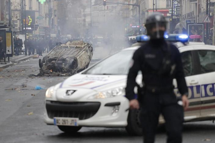 Running riots with police in Paris over the weekend left cars burned out and shops vandalised (AFP Photo/Thomas SAMSON)