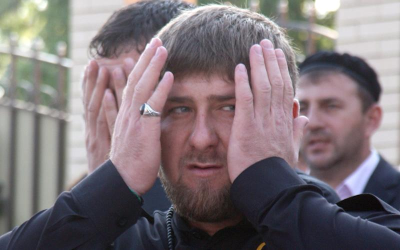 Chechen leader Ramzan Kadyrov prays as he visits a recently rebuilt district in the Chechnya's capital Grozny