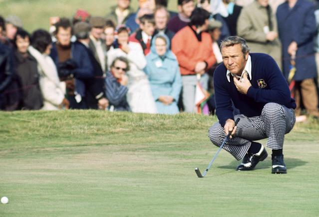 <p>Arnold Palmer of the USA lines up a putt during the Ryder Cup between Europe and the USA at Murifield in Scotland in September, 1973. (photo by Don Morley/Getty Images) </p>