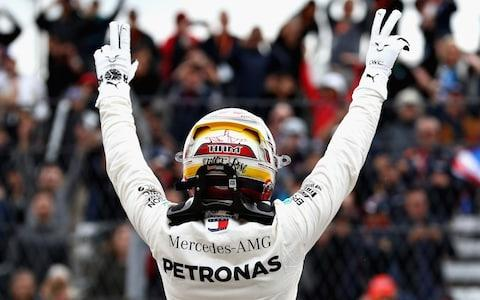 Pole position qualifier Lewis Hamilton of Great Britain and Mercedes GP celebrates in parc ferme during qualifying for the United States Formula One Grand Prix at Circuit of The Americas on October 20, 2018 in Austin, United States - Credit: getty images