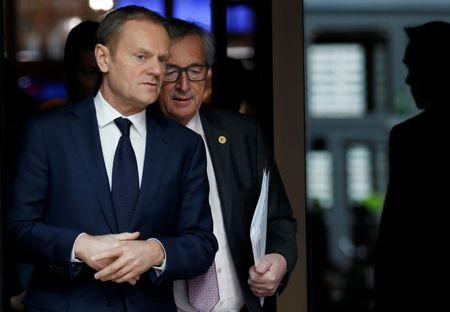 EU Council President Tusk and EU Commission President  Juncker arrive to address a news conference during a EU leaders summit in Brussels
