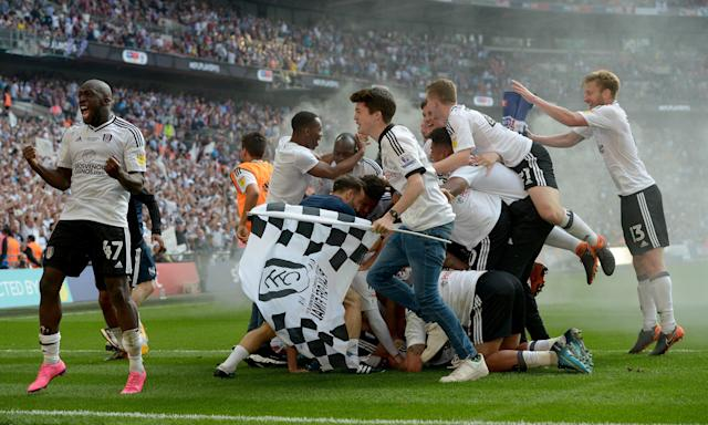 Fulham celebrate their promotion back to the Premier League.