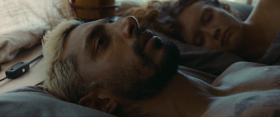 """Riz Ahmed (with Olivia Cooke) plays a rock drummer and former drug addict who struggles with losing his hearing in """"Sound of Metal."""""""