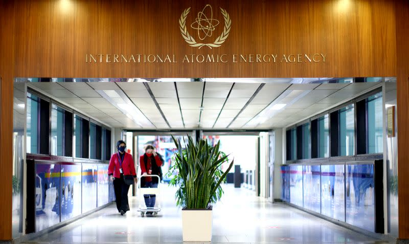 People walk along a corridor at the headquarters of the International Atomic Energy Agency (IAEA) in Vienna