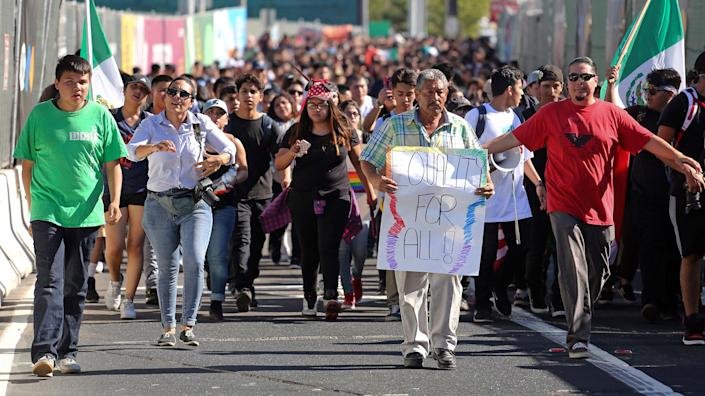 <p>Students from several high schools rally after walking out of classes to protest the election of Donald Trump as president in downtown Los Angeles, Calif., Monday, Nov. 14, 2016. (AP Photo/Reed Saxon) </p>