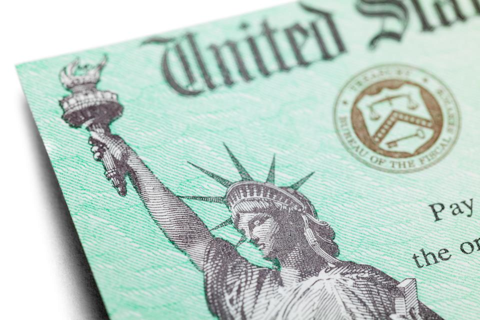 United States Tax Refund Check Close Up View of Statue of Liberty.
