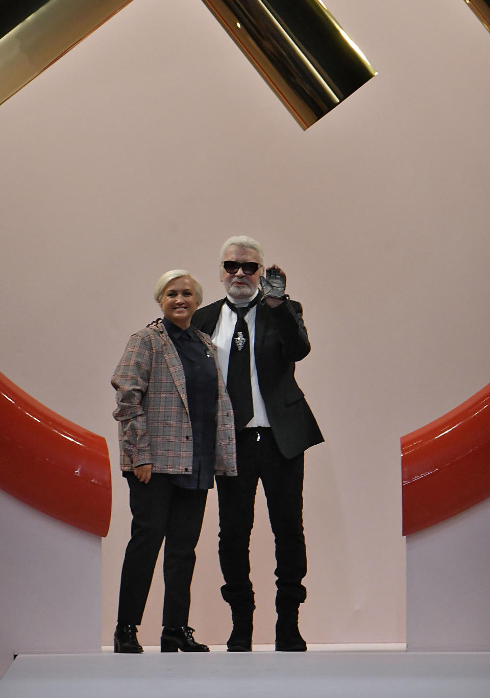 <p>Karl Lagerfeld walks out with Silvia Venturini Fendi following the SS19 Fendi show in Milan. <em>[Photo: Getty]</em> </p>