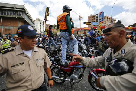 Motorcyclists take part in a protest against possible regulation and schedule bans as a measure to combat insecurity in Caracas January 31, 2014. REUTERS/Jorge Silva