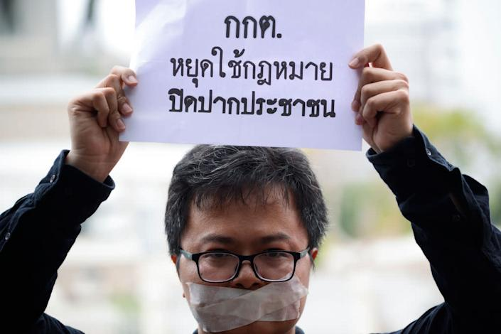 """Human rights lawyer Arnon Nampa holds a poster during election protests in Bangkok, Thailand on April 7, 2019. <span class=""""copyright"""">Anusak Laowilas—NurPhoto/Getty Images</span>"""