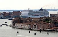 The MSC Orchestra cruise ship sails across the basin as it leaves Venice