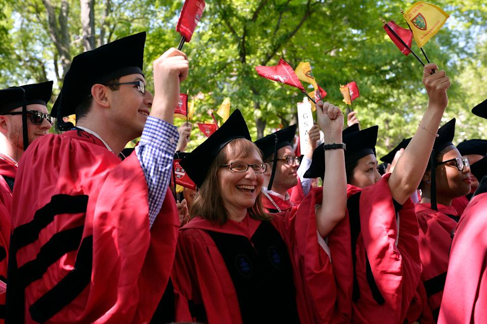 CAMBRIDGE, MA - MAY 24:  Students attend at the Harvard University 2018 367th Commencement exercises at Harvard University on May 24, 2018 in Cambridge, Massachusetts.  Receiving Honorary Degrees in 2018 are Sallie Chisholm, Rita Dove, Harvey Fineberg, Ricardo Lagos, George Lewis, Twyla Tharp and Wong Kar Wai. Representative John Lewis also attended.  (Photo by Paul Marotta/Getty Images)