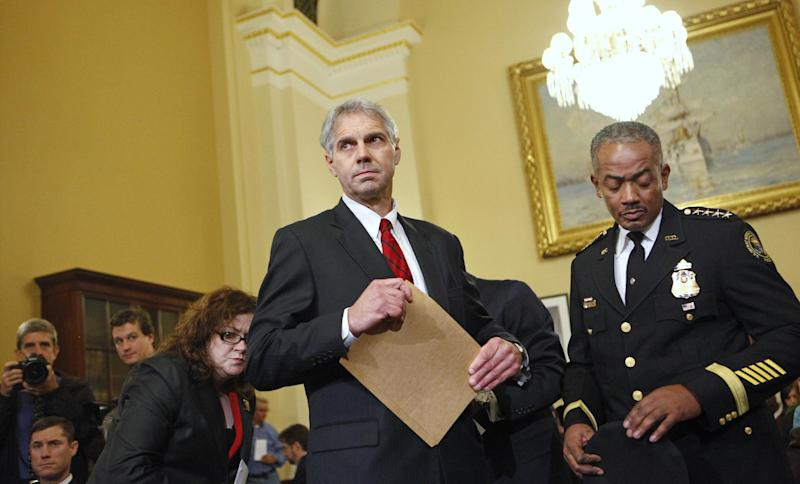 FILE - In this Thursday, Dec. 3, 2009 file photo, Secret Service Director Mark Sullivan, left, arrives on Capitol Hill in Washington to testify before the House Homeland Security Committee hearing on a White House security breach. At right is Curtis B. Eldridge Jr., chief of the United States Secret Service Uniformed Division. The Secret Service has been tarnished by a prostitution scandal that erupted April 13, 2012 in Colombia involving 12 Secret Service agents, officers and supervisors and 12 more enlisted military personnel ahead of President Barack Obama's visit there for the Summit of the Americas. (AP Photo/Haraz N. Ghanbari)