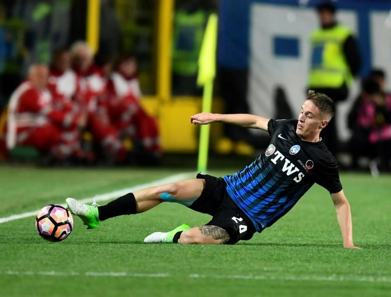 Italian defender Andrea Conti, pictured in April 2017, has just signed a deal with AC Milan, making him the football club's seventh recruit of the summer