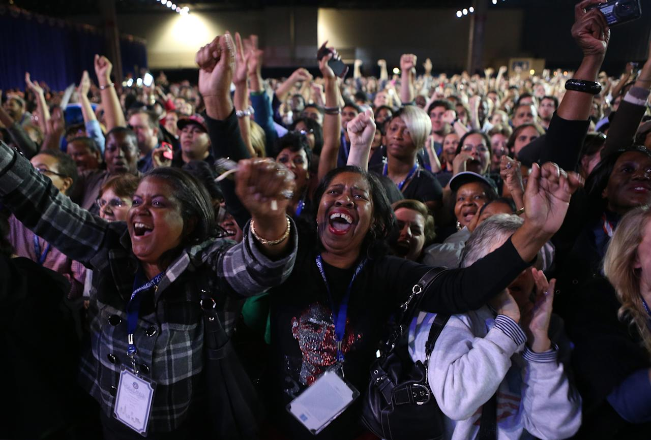 Supporters of U.S. President Barack Obama cheer during the Obama Election Night watch party at McCormick Place November 6, 2012 in Chicago, Illinois. Obama is going for reelection against Republican candidate, former Massachusetts Governor Mitt Romney.  (Photo by Chip Somodevilla/Getty Images)