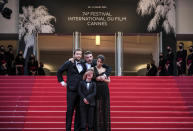 FILE - In this July 16, 2021 file photo Director Joachim Lafosse, from left, Gabriel Merz Chammah, Leila Bekhti and Damien Bonnard pose for photographers upon arrival at the premiere of the film 'The Restless' at the 74th international film festival, Cannes, southern France. (AP Photo/Vadim Ghirda, File)