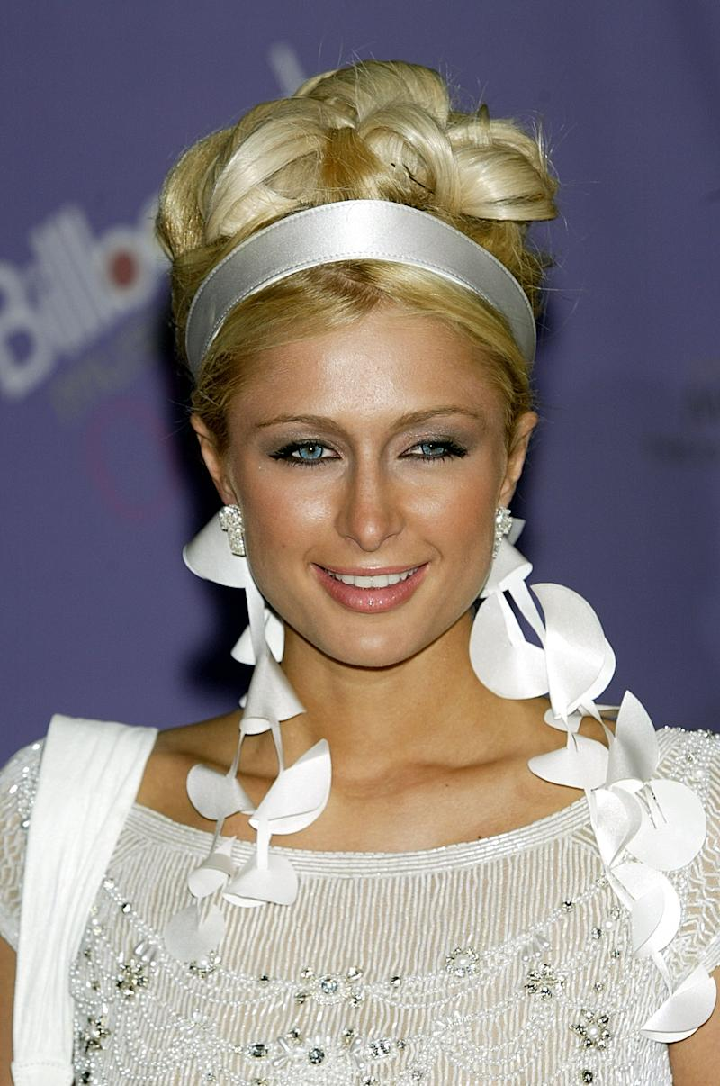LAS VEGAS - DECEMBER 10: Paris Hilton attends the 2003 Billboard Music Awards at the MGM Grand Garden Arena December 10, 2003 in Las Vegas, Nevada. The 14th annual ceremony airs live tonight on FOX 8:00-10:00 PM ET Live/PT. (Photo by Carlo Allegri/Getty Images)