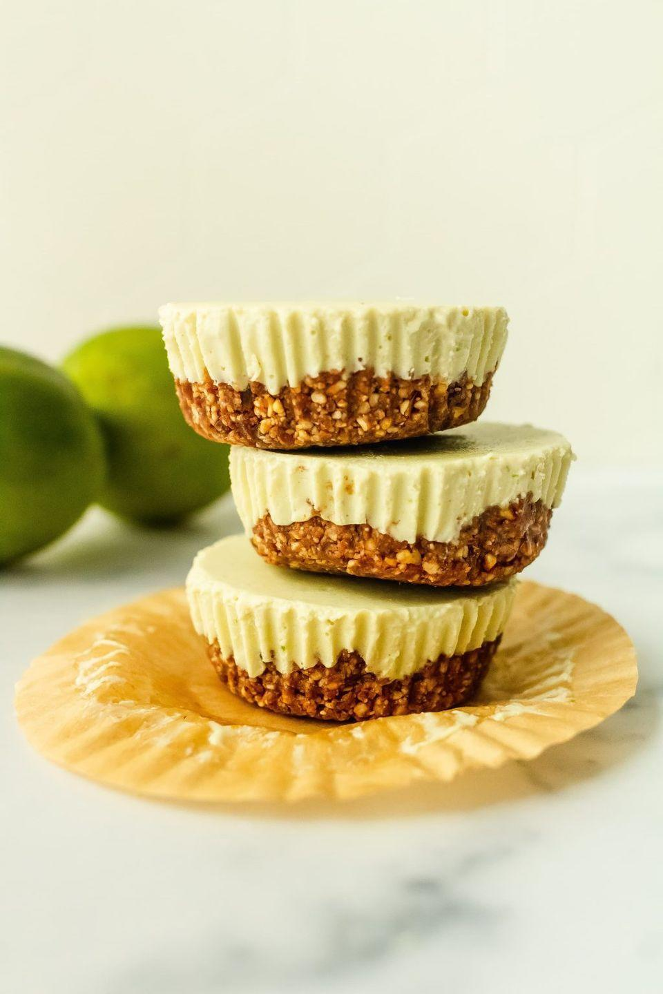 """<p>These little freezer cheesecakes have major tropical vibes and are made with healthy ingredients like dates, nuts, maple syrup, and yogurt. </p><p><a class=""""link rapid-noclick-resp"""" href=""""https://www.onceuponapumpkinrd.com/no-bake-key-lime-pie-cheesecakes/"""" rel=""""nofollow noopener"""" target=""""_blank"""" data-ylk=""""slk:GET THE RECIPE"""">GET THE RECIPE</a></p><p><em>Per serving: 199 calories, 14 g fat, 14 g carbs, 110 mg sodium, 7.5 g sugar, 3 g fiber, 5.7 g protein</em></p>"""