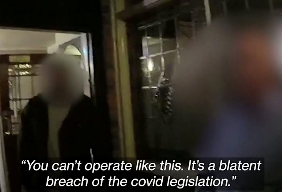 Footage captured by officers showed the moment they confronted the pub's landlord. (SWNS)