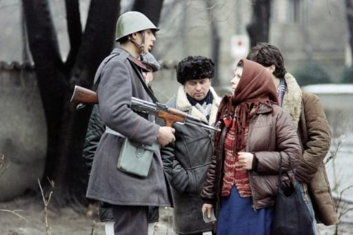 A Romanian soldier with civilians in Bucharest, December 1989