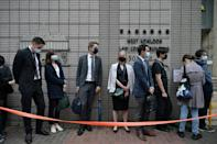 Diplomatic representatives from (L-4th R) The Netherlands, France, Sweden, Canada and Australia wait to enter the West Kowloon court in Hong Kong