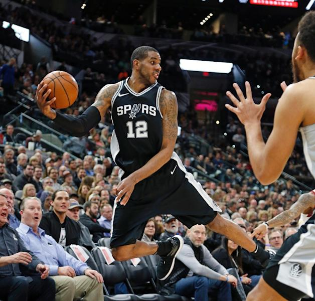 LaMarcus Aldridge scored 19 of his 33 points in the fourth quarter and grabbed 12 rebounds for the Spurs in an 89-75 victory over the injury ravaged Golden State Warriors (AFP Photo/Ronald Cortes)