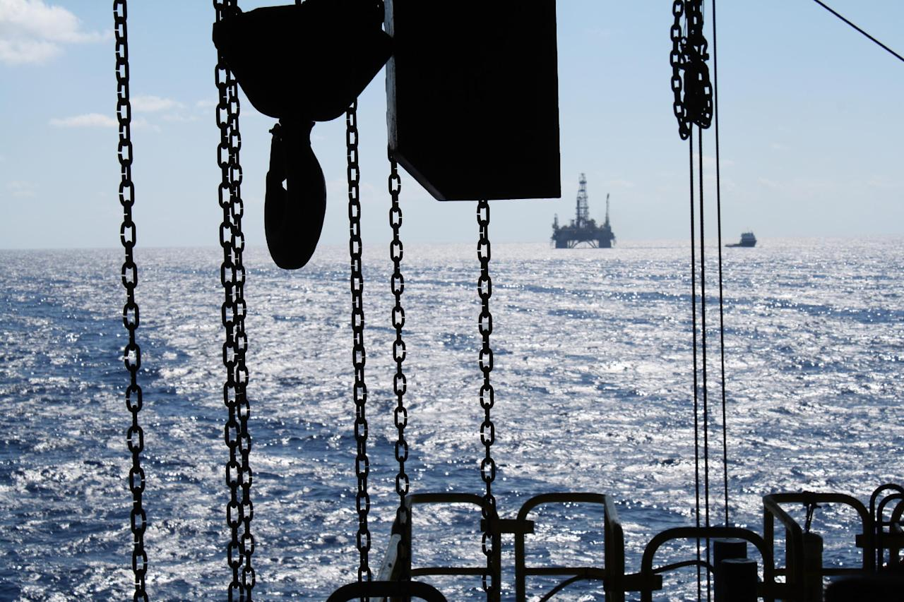 """In this Oct. 27, 2011 photo, the satellite oil rig """"Danny Adkins,"""" owned by Noble Oil, can be seen on the horizon from the Perdido platform. (AP Photo/Jon Fahey)"""