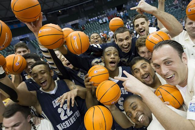 The George Washington basketball team pose after an NCAA college basketball game against Wichita State at the Diamond Head Classic on Thursday, Dec. 25, 2014, in Honolulu. George Washington won 60-54. (AP Photo/Eugene Tanner)