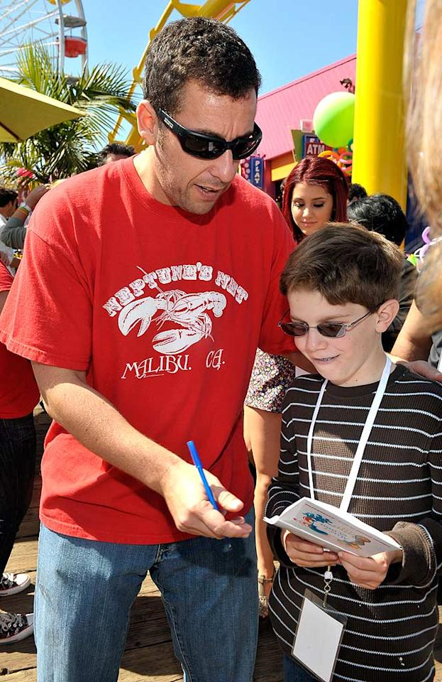 """Funnyman Adam Sandler made time to sign autographs for his pint-sized fans. The father of two has often supported kids' causes in the past, even donating $1 million to the Boys & Girls Club in his hometown of Manchester, New Hampshire, in 2007. Charley Gallay/<a href=""""http://www.gettyimages.com/"""" target=""""new"""">GettyImages.com</a> - March 14, 2010"""