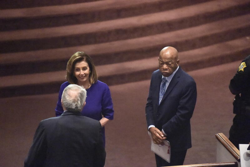 House Speaker Nancy Pelosi, U.S. Reps. GK Butterfield, left, and John Lewis, right, speak on Sunday, Sept. 22, 2019, at funeral services for Emily Clyburn, wife of House Majority Whip Jim Clyburn of South Carolina, in West Columbia, S.C. (AP Photo/Meg Kinnard)