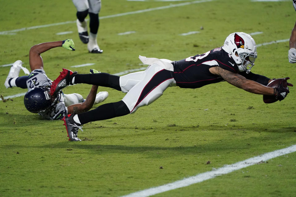 Arizona Cardinals wide receiver Christian Kirk (13) lunges for a touchdown as Seattle Seahawks cornerback Quinton Dunbar (22) defends during the second half of an NFL football game, Sunday, Oct. 25, 2020, in Glendale, Ariz. (AP Photo/Ross D. Franklin)