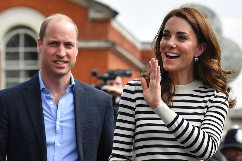 Kate Middleton and her husband Prince William taking a stroll in casual clothing as she waves to the crowd