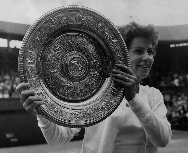 4th July 1964: Marion Bueno of Brazil with the Women's Singles Championship trophy which she won at Wimbledon by beating Australian Margaret Smith (Margaret Court). (Photo by Douglas Miller/Keystone/Getty Images)