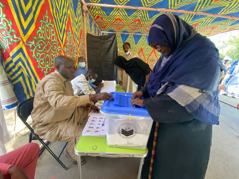 A woman casts her ballot at the pooling station during the presidential election in N'Djamena