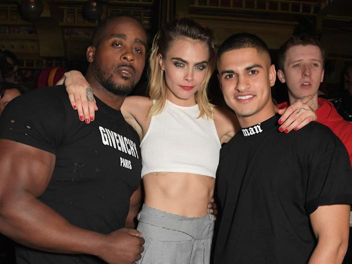 Samir is photographed here with model Cara Delevingne.