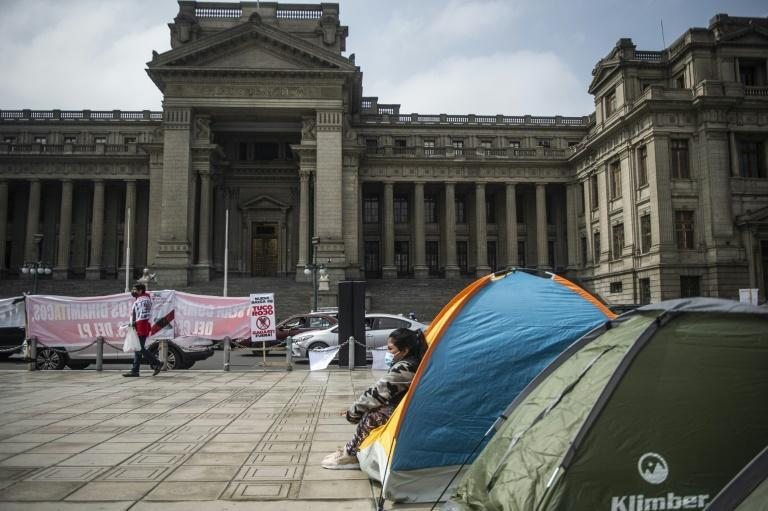 Supporters of Peruvian candidate for the Fuerza Popular party, Keiko Fujimori, camp outside the Justice Palace in Lima on July 06, 2021