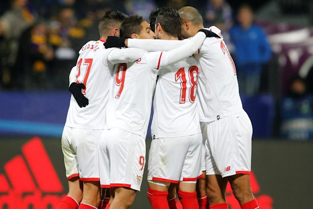 Soccer Football - Champions League - NK Maribor vs Sevilla - Ljudski vrt, Maribor, Slovenia - December 6, 2017 Sevilla players celebrate scoring their first goal REUTERS/Srdjan Zivulovic