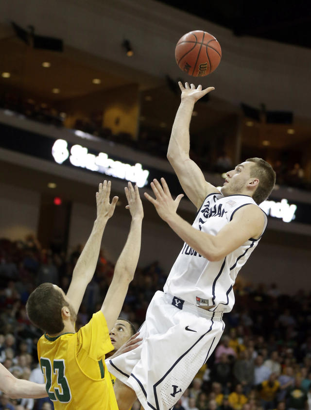 San Francisco's Mark Tollefsen covers a shot from BYU's Kyle Collinsworth during the second half of a West Coast Conference tournament NCAA college basketball game Monday, March 10, 2014, in Las Vegas. BYU defeated San Francisco 79-77 in overtime. (AP Photo/Isaac Brekken)