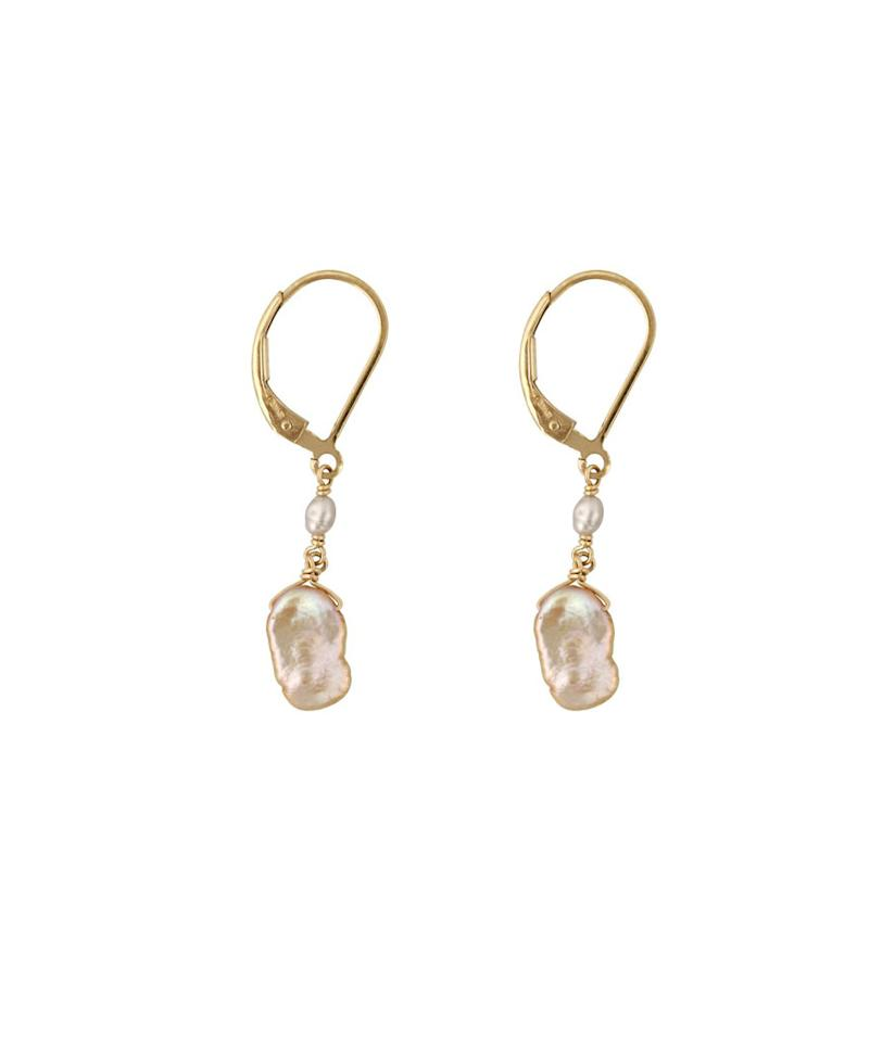 """<p>Sea-inspired jewelry is a big trend in fashion. Show her that you know what's hip, and gift her this gorgeous pair of earrings from Washed Ashore. They are 14-karat yellow gold and feature wire-wrapped pearls. <br /><a rel=""""nofollow"""" href=""""https://fave.co/2R4xegp""""><strong>Shop it:</strong> </a>$175, <a rel=""""nofollow"""" href=""""https://fave.co/2R4xegp"""">washedashore.co</a> </p>"""