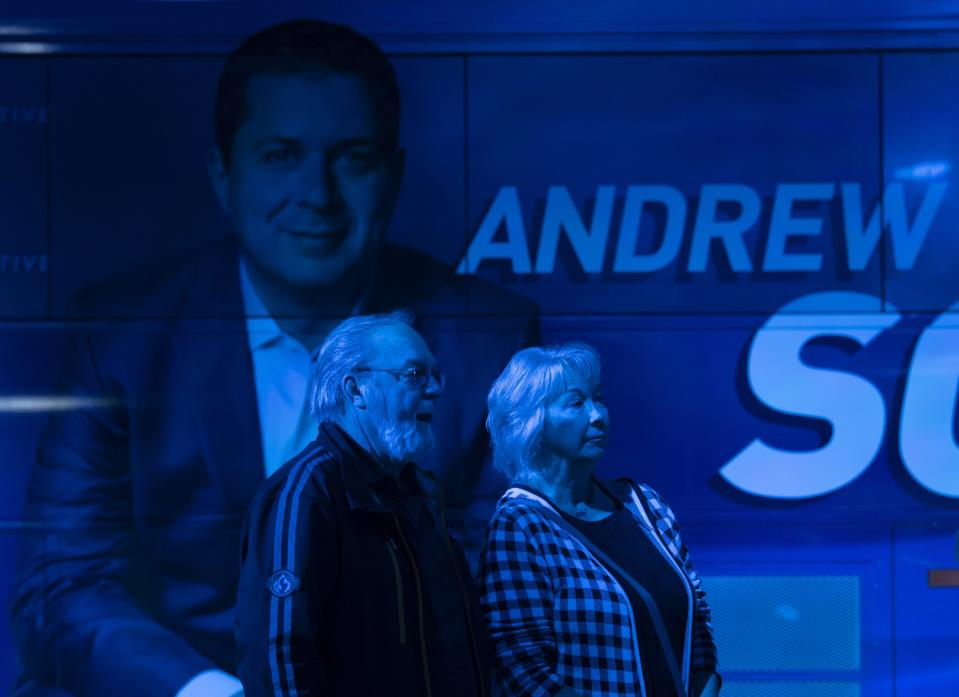 Conservative supporters wait at Conservative headquarters in Regina, Monday, October 21, 2019. THE CANADIAN PRESS/Adrian Wyld