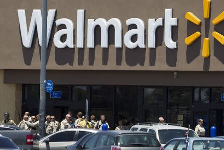 Metro Police officers are shown outside a Walmart after a shooting in Las Vegas June 8, 2014. REUTERS/Las Vegas Sun/Steve Marcus