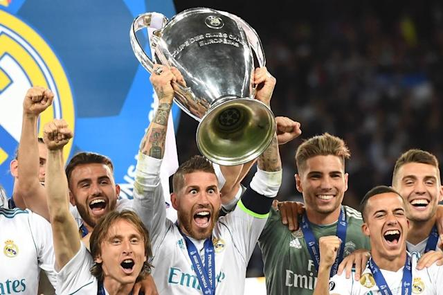 Sergio Ramos celebrated Real's third Champions League in a row (AFP Photo/Paul ELLIS)