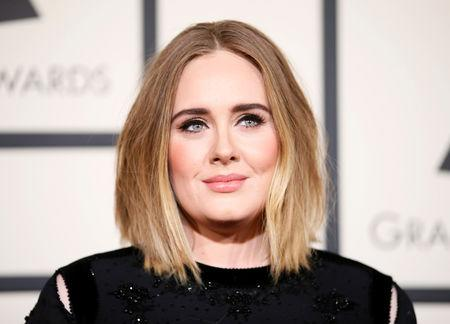 Adele to release heartbreak album after split from husband